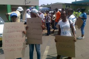 Young-women-with-placards-as-the-marchers-gather1 (1)